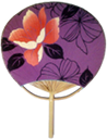 A Japanese fan with a flower pattern