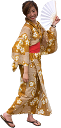 A woman in a yukata holding a fan